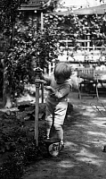 0229914 © Granger - Historical Picture ArchivePEOPLE.   German Empire: Gardening - girl at a water tap in a garden - undated Vintage property of ullstein bild.