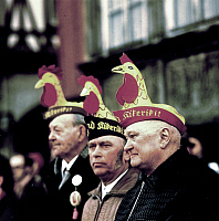 0230142 © Granger - Historical Picture ArchivePEOPLE.   German Democratic Republic - Eisenach: festival commitee members of the traditional Sommergewinnfest wearing caps in the form of cocks - date unknown, March 1983.