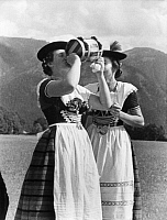0230820 © Granger - Historical Picture ArchivePEOPLE.   German Empire - Bayern Freistaat (Bavaria Free State) (1918-1945) - Rottach: Upper Bavaria: Women drinking beer on tap in a festival with traditional costumes - Photographer: Alfred Eisenstaedt - Published by: 'Uhu' 03/1932 Vintage property of ullstein bild.