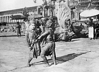 0231126 © Granger - Historical Picture ArchivePEOPLE.   Thailand - Bangkok - Temple-dancers wearing gorgeous garment, masks and precious jewels. The most famous art form is the dance-drama, the Khon-dance. - Photographer: W. Gircke - 1920 Vintage property of ullstein bild.