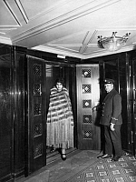 0231753 © Granger - Historical Picture ArchivePEOPLE.   Steamship Columbus of the shipping company Norddeutscher Lloyd. Liftboy hold a female passenger the door. - Photographer: Heinrich Engelke - Published by: Fridolin 8/1926 Vintage property of ullstein bild.