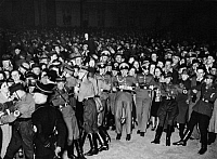 0232259 © Granger - Historical Picture ArchivePEOPLE.   During the opening of the Ost-West-Achse (today the Strasse des 17. Juni) on the evening before Hitler's birthday: policemen and SA-men hold back the exited crowd - Photographer: Heinz Fremke - Published by: 'Berliner Morgenpost' 20.04.1939 Vintage property of ullstein bild.