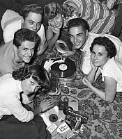 0232596 © Granger - Historical Picture ArchivePEOPLE.   Boys and girls lying around a record-player and listening to records in the youth - club Panda-Klub - 1956 Also available in color: Image Number 639938.