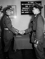 0233643 © Granger - Historical Picture ArchiveMILITARY.   German Democratic Republic Foundation of the People's National Army a young member of the first regiment of the PNA in Oranienburg is being congratulated on his swearing-in by an officer - - 30.04.1956.