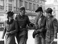 0233793 © Granger - Historical Picture ArchiveMILITARY.   German Empire Free State Prussia Brandenburg Province Berlin: Reportage from the NS magazin 'Erika': Where do all the nice Berlin women come from? Erika walking with a soldier on furlough on Tauentzienstrasse - Photographer: Hanns Hubmann - Published by: 'Erika' 19/1940 Vintage property of ullstein bild.
