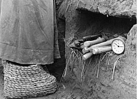 0233822 © Granger - Historical Picture ArchiveMILITARY.   Russia, Military: clock, flare gun and hand grenades lying in a trench at North Caucasus - Photographer: Bernd Lohse - 1942 Vintage property of ullstein bild.