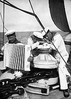0233884 © Granger - Historical Picture ArchiveMILITARY.   Sail training ship 'Gorch Fock', shipboys are listening the accordion in a break - Photographer: Curt Ullmann - Published by: 'Hier Berlin' 17/1938 Vintage property of ullstein bild.
