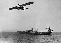 0234101 © Granger - Historical Picture ArchiveMILITARY.   Series: Germany, flying ship on board of the 'Westfalen', aircraft catapult ship: the 'Dornier-Wal-Flugboot' flying above the 'Westfalen' - Photographer: Willi Ruge - 1933 Vintage property of ullstein bild.