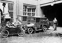 0235118 © Granger - Historical Picture ArchiveTRANSPORTATION.   Germany Berlin: shipping of the newspaper 'BZ am Mittag', in the foreground a compact car with electric motor - date unknown, probably 1920.