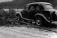 0235192 © Granger - Historical Picture ArchiveTRANSPORTATION.   Norway : 'Fjord-Garage', the car standing on a wooden construction on the roadside - Photographer: Bernd Lohse - Published by: 'Berliner Illustrirte Zeitung' 45/1940 Vintage property of ullstein bild.