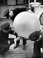 0235451 © Granger - Historical Picture ArchiveTRANSPORTATION.   : Aboard of the ocean liner 'Albert Ballin' of the Hamburg-America Line (HAL/HAPAG), seaman filling a small meteorological balloon - Photographer: Paul Mai - 1936 Vintage property of ullstein bild.