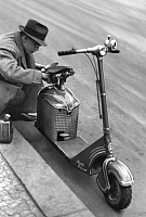 0235650 © Granger - Historical Picture ArchiveTRANSPORTATION.   German Empire Free State Prussia: young man refuels with a funnel his motor scooter - Photographer: Heinz Fremke - Published by: 'Das 12 Uhr Blatt' 29.11.1938 Vintage property of ullstein bild.