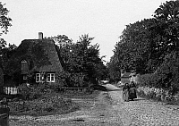 0241508 © Granger - Historical Picture ArchiveNATURE.   Germany, North Frisian Islands, Foehr Island, two women on a quiet village street, date unknown, probably around 1917, photo by Hans Breuer.