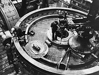 0241824 © Granger - Historical Picture ArchiveINDUSTRY.   German Empire : Siemens generator factory , construction of a generator, preparing a magnet wheel for the fitting - Photographer: Bernd Lohse - Published by: 'Signal' 12/1943 Vintage property of ullstein bild.