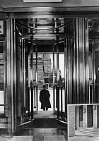 0241921 © Granger - Historical Picture ArchiveINDUSTRY.   I.G. Farbenindustrie A.G (IG Farben) - chemical plant. The doors in the new administrative building at Leverkusen open and shut automatically by controll of photo-cells. July 1939 Photo: Braemer and Guell.