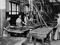 0241973 © Granger - Historical Picture ArchiveINDUSTRY.   Switzerland, chocolate manufacturer Kohler, factory workshop workers at the vibrating tables, which help to put the chocolate into the planned form. - no date (around 1908) image is part of a series..