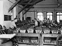 0242112 © Granger - Historical Picture ArchiveINDUSTRY.   Switzerland, chocolate manufacturer Kohler, factory workshop workers filling the mixed chocolate.into kneading throughs - no date (around 1908) image is part of a series..