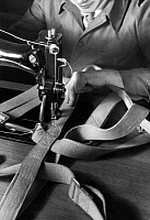 0242122 © Granger - Historical Picture ArchiveINDUSTRY.   German Reich, parachute fabrication: seamstress at the sewing machine sewing the harness - Photographer: Heinz Fremke - 1939 Vintage property of ullstein bild.