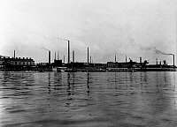 0242148 © Granger - Historical Picture ArchiveINDUSTRY.   I.G. Farbenindustrie A.G (IG Farben) - chemical plant. Leverkusen : Wharfage at the Rhine river 1927.