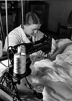 0242168 © Granger - Historical Picture ArchiveINDUSTRY.   German Reich, parachute fabrication: seamstress at the Duerkopp sewing machine - Photographer: Heinz Fremke - 1939 Vintage property of ullstein bild.