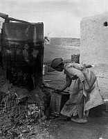 0242669 © Granger - Historical Picture ArchiveECONOMY.   Iraq, young Arab filling a jerrican with petroleum - Photographer: Max Ehlert - 1935 Vintage property of ullstein bild.
