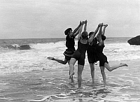0243048 © Granger - Historical Picture ArchiveLEISURE.   Belgium, Flanders, Ostende: four women in bathing suits dancing in crashing waves, date unknown, probably around 1913.