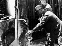 0243967 © Granger - Historical Picture ArchiveCELEBRATION.   German Empire - Brandenburg - Berlin: food control, pump water filling in bins for a bacteriological and technical controll - 1933 Vintage property of ullstein bild.