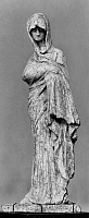 0244954 © Granger - Historical Picture ArchiveFASHION.   greek art - woman in long coat thrown over - found in Tanagra - Published in 'Zeitbild' 19 / 1914 - 1914.