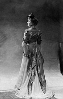 0245195 © Granger - Historical Picture ArchiveFASHION.   Miss Siding from the Berlin Theater Metropol-Theater wearing a frock in the louis-quinze style made from white chiffon with lace decorated blue jacket, back view - undated Vintage property of ullstein bild.