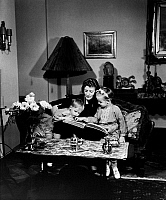 0245490 © Granger - Historical Picture ArchiveLIFESTYLE.   Emmi LEISNER (*1885-1958+), German opera singer, Leisner with children of German minister of the interior Wilhelm Frick, Dieter and Renate, at her flat, c1936-1940, photography by Hedda Walther.