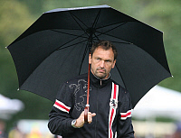 0262509 © Granger - Historical Picture ArchiveCLAUS WOLLITZ.   Wollitz, Claus-Dieter - Soccer, Coach, FC Energie Cottbus, Germany - holding an umbrella - 10.07.2009. Behrendt / contrast - ullstein bild / Granger, NYC -- All ri.