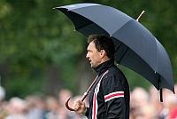 0262513 © Granger - Historical Picture ArchiveCLAUS WOLLITZ.   Wollitz, Claus-Dieter - Soccer, Coach, FC Energie Cottbus, Germany - holding an umbrella - 10.07.2009. Behrendt / contrast - ullstein bild / Granger, NYC -- All ri.