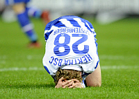 0263547 © Granger - Historical Picture ArchiveFABIAN LUSTENBERGER.   Lustenberger, Fabian - Soccer, Midfielder, Hertha BSC Berlin, Switzerland - kneeling on the pitch, head down - 08.11.2009. Sven Simon - ullstein bild / Granger, NYC -- All Rights Reserved.