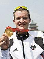 0263895 © Granger - Historical Picture ArchiveCHINA .   China - Peking Beijing: Olympic Games 2008 - Triathlon Men's Final, Run - Olympic champion Jan Frodeno (GER) showing his gold medal - 19.08.2008 *** Local Caption *** 01007276. Sven Simon - ullstein bild / Granger, NYC -- All righ