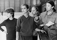 0265566 © Granger - Historical Picture ArchiveKATARINA WITT (1965-).   German figure skater. Photographed during a training session, 1984. Left to right: Simone Lang, Witt, Constanze Gensel, and trainer Jutta Mueller. Full credit: ADN-Bildarchiv - ullstein bild / Granger, NYC -- All ri.