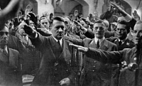 0267233 © Granger - Historical Picture ArchiveADOLF HITLER (1889-1945).   Chancellor of Germany, 1933-45. Hitler at the Memorial to the Beer Hall Putsch in Munich, Germany. From left: Joseph Goebbels, Adolf Hitler, Karl Fiehler, Philipp Bouhler, and Ulrich Graf. Photograph, 1942. Full credit: Heinrich Hoffmann - ullstein bild / Granger, NYC -- All Rights Reserved.