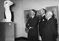 0267821 © Granger - Historical Picture ArchiveADOLF HITLER (1889-1945).   Chancellor of Germany, 1933-1945. Viewing an art exhibition in Berlin with the French ambassador Andre Francois-Poncet. Photograph by Heinrich Hoffmann, 1937.