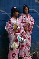 0267979 © Granger - Historical Picture ArchiveJAPAN: KIMONOS, 2008.   Two young women wearing kimonos at a local Matsuri festival in Yokkaichi, Japan. Photograph, 2008. Full credit: Dunzl - ullstein bild / Granger, NYC -- All Rights Reserved.