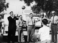 0268618 © Granger - Historical Picture ArchiveRONALD REAGAN (1911-2004).   40th President of the United States. Playing with a football while campaigning for governor of California, 1966.