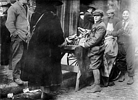 0118516 © Granger - Historical Picture ArchiveBOSTON: MARKET, c1917.   Young fruit vendors selling bananas at a market in Boston, Massachusetts. Photograph by Lewis Hine, c1917.