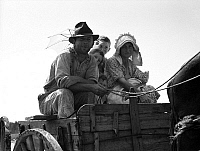 0123099 © Granger - Historical Picture ArchiveSHARECROPPER FAMILY, 1937.   A former sharecropper family traveling in a horse drawn carriage near Hazlehurst, Georgia. Photograph by Dorothea Lange, July 1937.