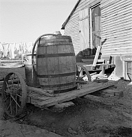 0124143 © Granger - Historical Picture ArchiveDRINKING WATER, 1939.   A barrel of drinking water for when the farm irrigation water is shut off in mid October, in Dead Ox Flat, Malheur County, Oregon. Photograph by Dorothea Lange, October 1939.
