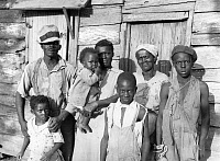 0002424 © Granger - Historical Picture ArchiveSHARECROPPER, 1936.   Lewis Hunter and his family outside their home at Lady's Island, Beaufort, South Carolina. Photograph by Carl Mydans, 1936.
