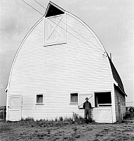 0123508 © Granger - Historical Picture ArchiveOREGON: BARN, 1939.   A farmer from Nebraska with his new barn on the Yamhill farms relief project in Yamhill County, Oregon. Photograph by Dorothea Lange, October 1939.