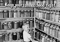 0323129 © Granger - Historical Picture ArchiveFSA SLIDE FILM, c1940.   'Keep your canned food right.' Photograph by Marion Post Wolcott, from a Farm Security Administration slide film, c1940.