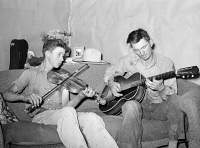 0351998 © Granger - Historical Picture ArchiveMUSICIANS, 1940.   A farmer and his brother playing music at home in Pie Town, New Mexico. Photograph by Russell Lee, 1940.
