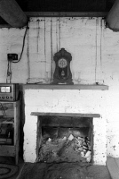 0352015 © Granger - Historical Picture ArchiveADOBE HOUSE, 1940.   A fireplace in an adobe house in Pie Town, New Mexico. Photograph by Russell Lee, 1940.