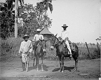 0124028 © Granger - Historical Picture ArchiveCUBA: SUGAR PLANTATION.   Three cane cutters on a Cuban sugar plantation. Photograph, early 20th century.