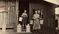 0131590 © Granger - Historical Picture ArchiveHINE: DAIRY FARM, 1916.   A farmer's son and daughter carrying pails of milk on a dairy farm in the Elizabethtown vicinity of Kentucky. Photograph by Lewis Hine, May 1916.