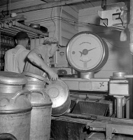 0324420 © Granger - Historical Picture ArchiveVERMONT: CREAMERY, 1941.   Weighing milk as it comes in from the farmers at the United Farmers' Cooperative Creamery in Sheldon Springs, Vermont. Photograph by Jack Delano, 1941.
